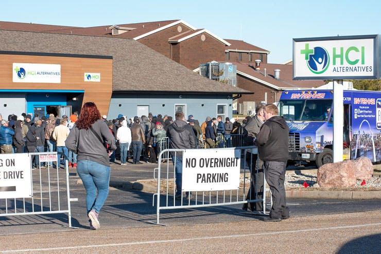 Hundreds line up outside a marijuana dispensary in Illinois