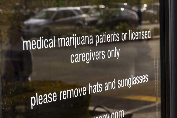 A sign on the door of a medical marijuana dispensary. (Jonathan Weiss/Shutterstock)