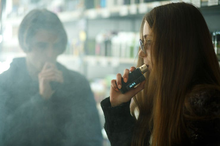 Teenagers using vaporizers