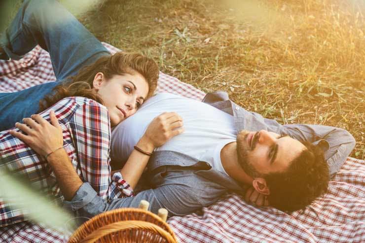 Couple cuddling on a picnic