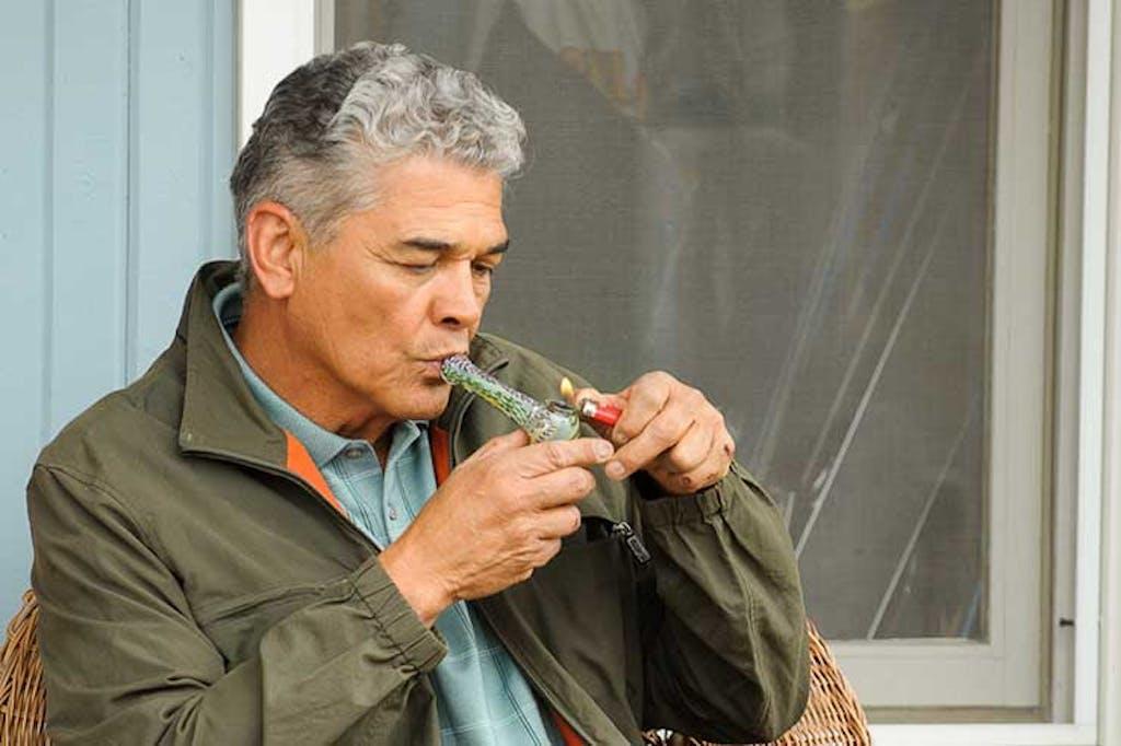 older man smoking cannabis