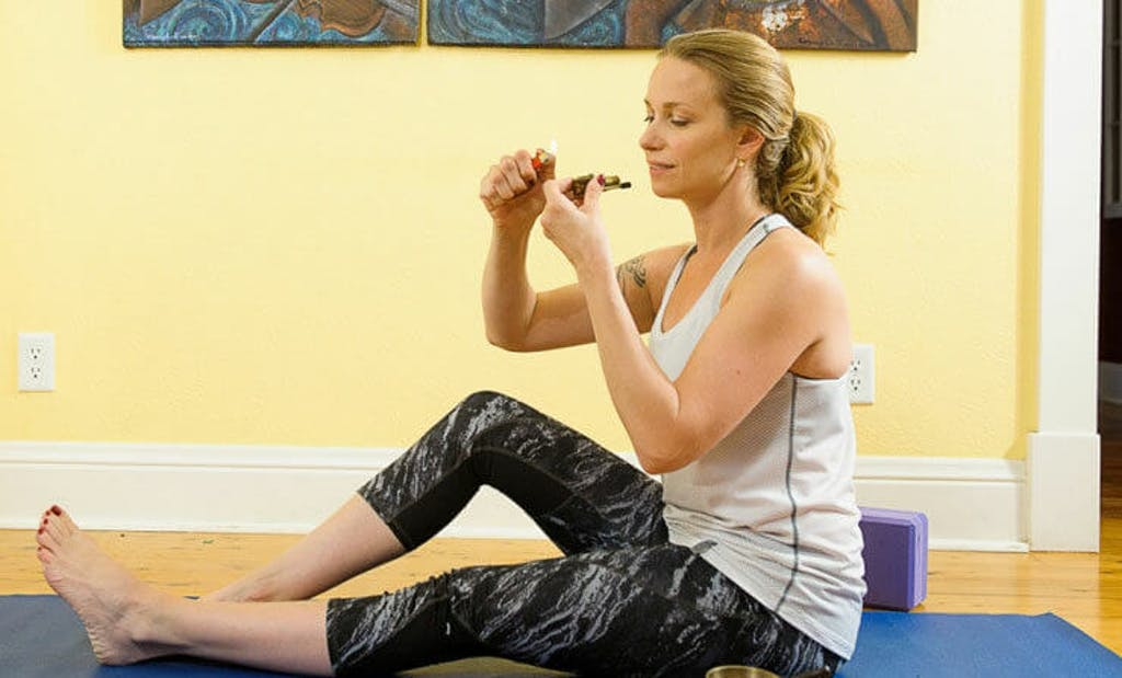 woman-smoking-marijuana-doing-yoga