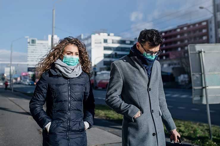 Man and woman wearing surgical masks corona virus