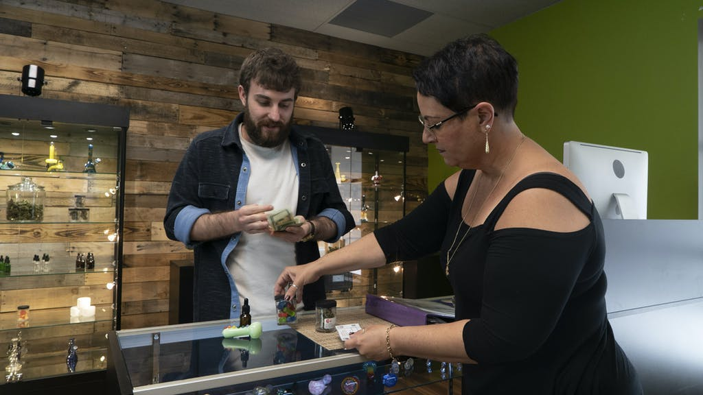 Paying cash for cannabis in a dispensary
