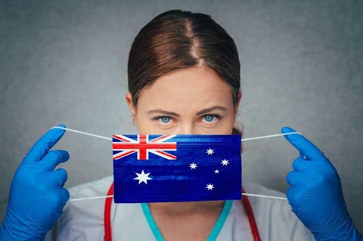 An Australian doctor with a flag mask