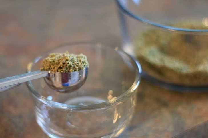 Measuring marijuana to make oil for cannabis edibles