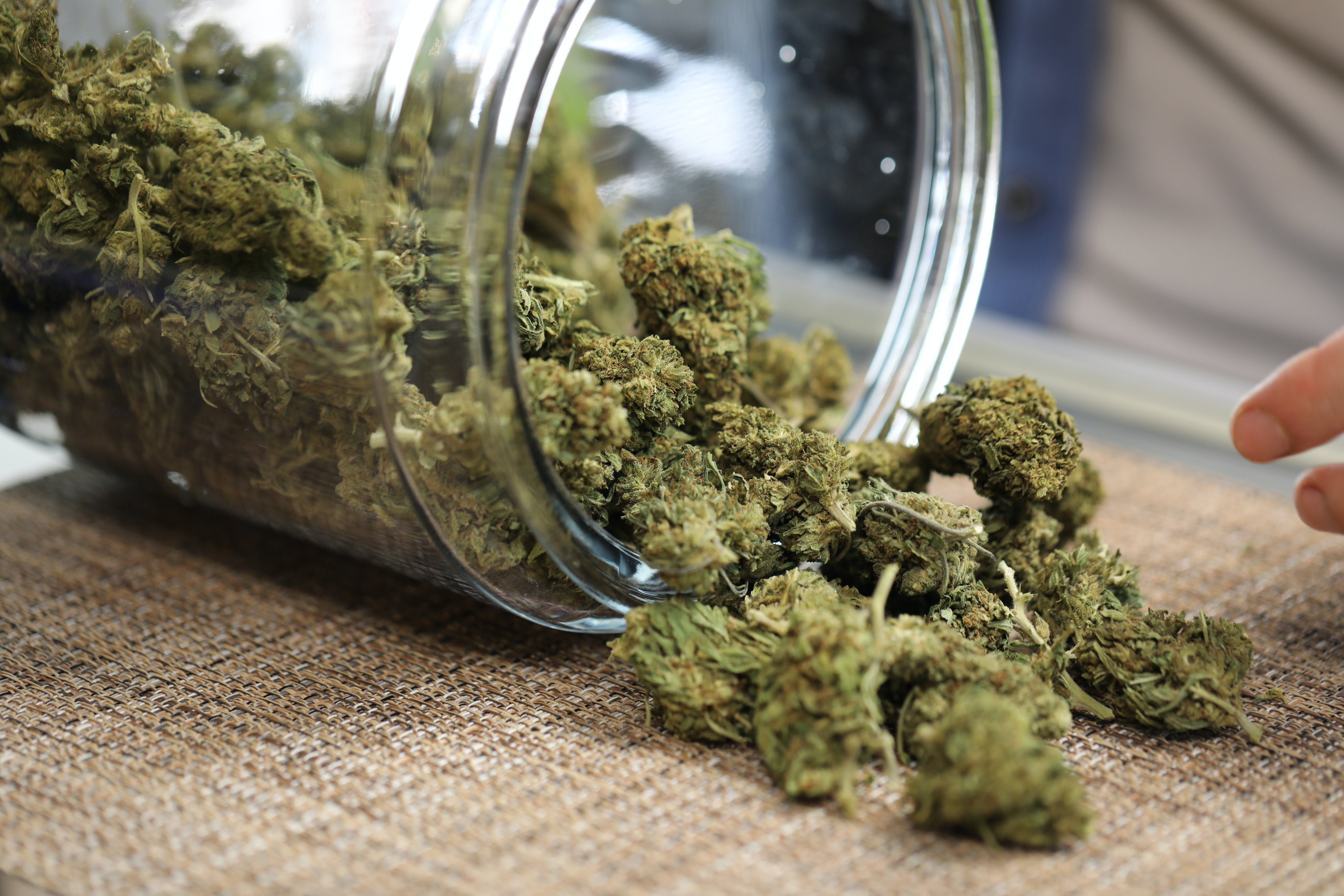 A jar of cannabis in a dispensary
