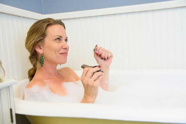 smoking marijuana from a pipe in the bath