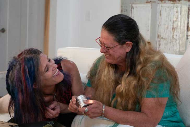 Two mothers laugh after smoking a joint