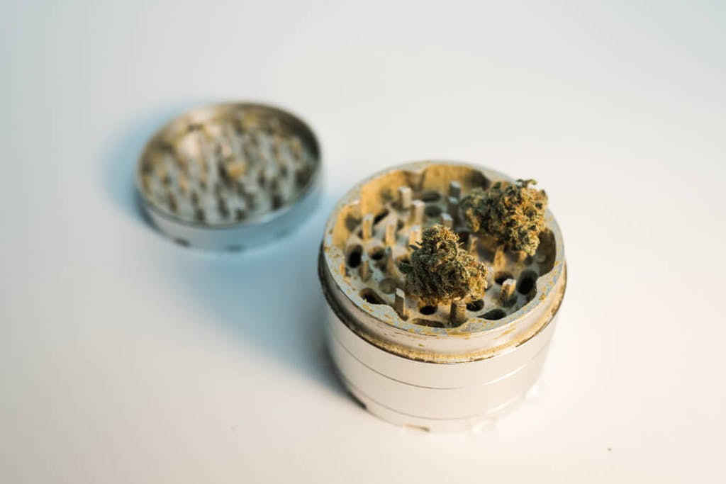 Cannabis in a multi-chamber grinder