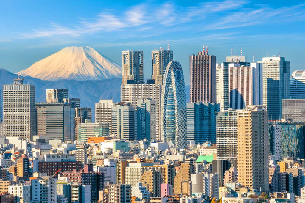 Mt Fuji is seen against the cityscape ofTokyo