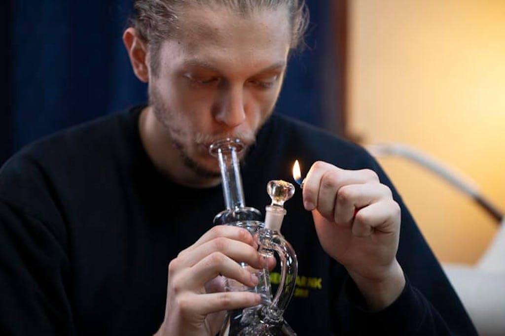 Smoking marijuana from a bong