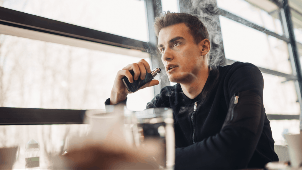 Man vaping in closed public space