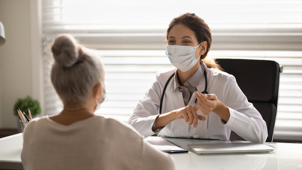 A patient discusses medical marijuana with her doctor