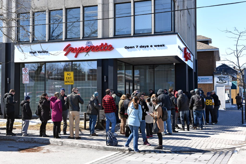 Customers wait in line to enter the marijuana dispensary on the first day for legal retail store sale of cannabis in Ontario