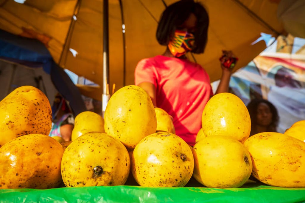 Mangos being sold at a stand in a market