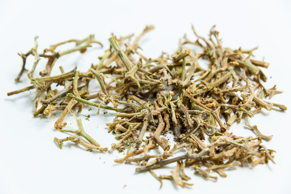 A pile of collected cannabis stems