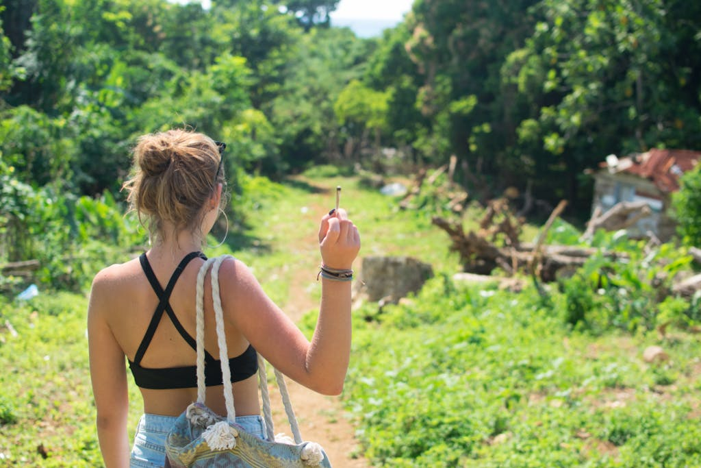 Back view of woman smoking weed in Jamaica.