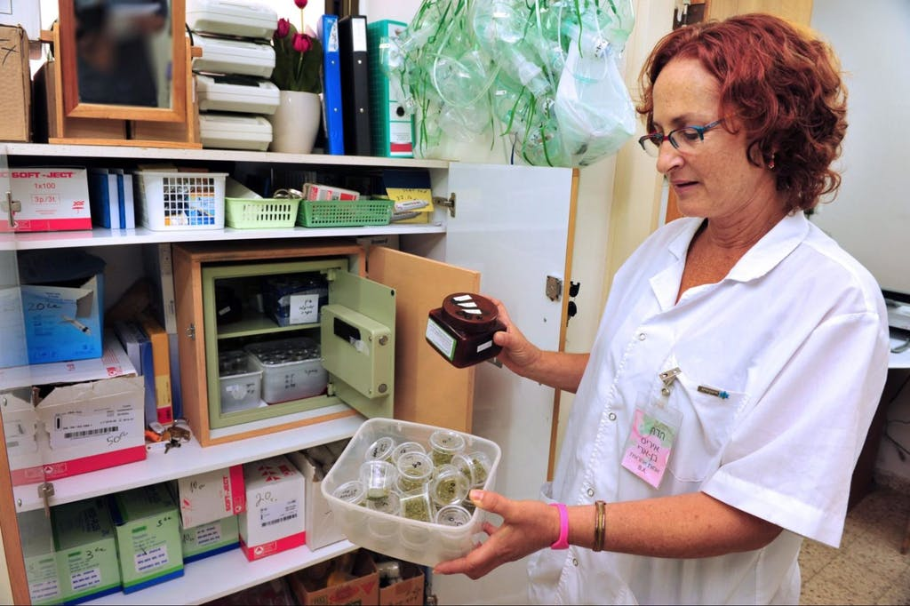 A nurse holding medical cannabis in a retirement home in Rehovot, Israel