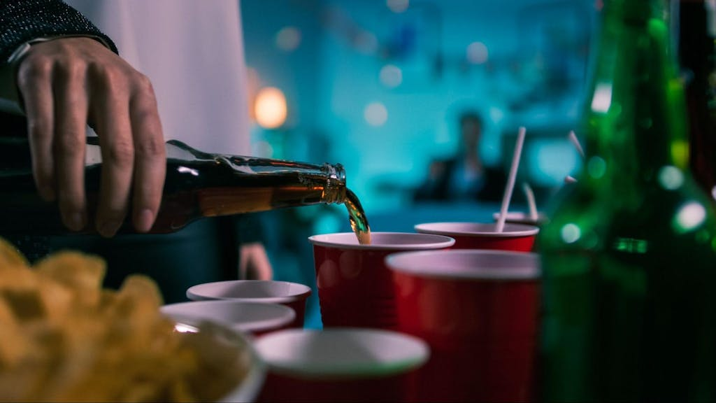 Drinking beer at a college party